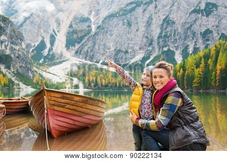 Mother And Daughter On Lake Bries Shores With Wooden Boat