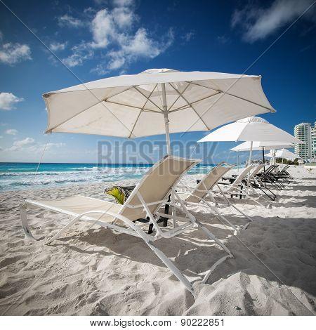 Caribbean Beach With Sun Umbrellas And Beds