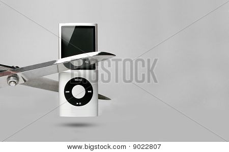 Grey Portable Music Player And Scissors