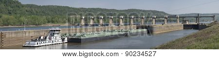 Barge with Oil Entering Lock and Dam on a River