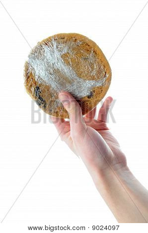 Hand Holding Plastic Wrapped Cookie