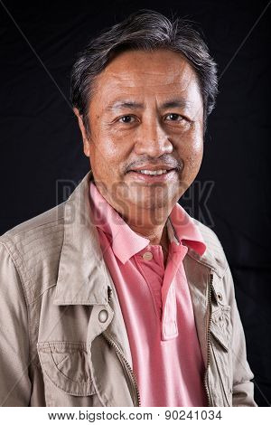 Portrait Close Up Smiling Happiness Face Of 59S Years Old Asian Man With Studio Light Against Black