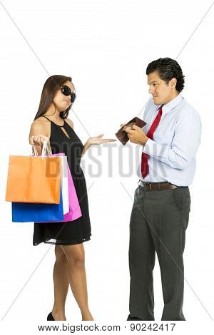 A greedy shopaholic gold digger superficial wife shrugging and demanding cash from her poor husband showing his empty wallet with no money. poster