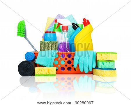 Cleaning supplies in a basket - cleaning and housekeeping concept poster