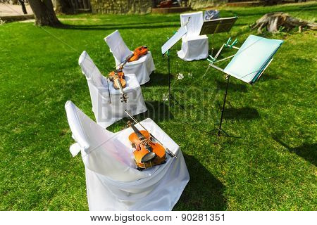 Outdoors Wedding Ceremony - String Quartet's Chairs With Instruments
