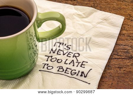 It is never too late to begin - motivational reminder on a napkin with a cup of coffee