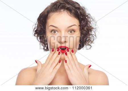 Young attractive woman looks amazed.