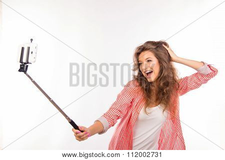 Happy Young Woman  With Hat Making Selfie Photo With Stick