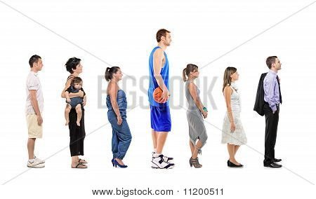 Full Length Portrait Of Different Men And Women Standing Together In A Line