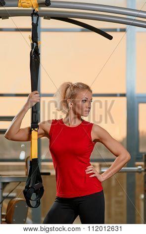 Athletic woman trx portrait