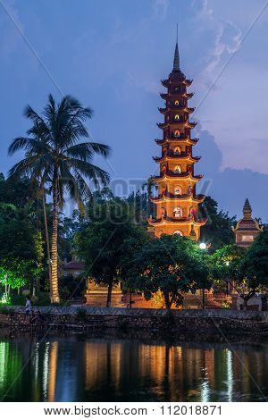 Lights Of Tran Quoc Pagoda Reflected In Lake By Night,  Hanoi