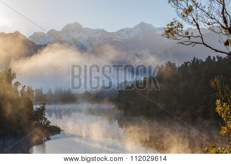 View Of Southern Alps From Lake Matheson In The Early Morning Mist.