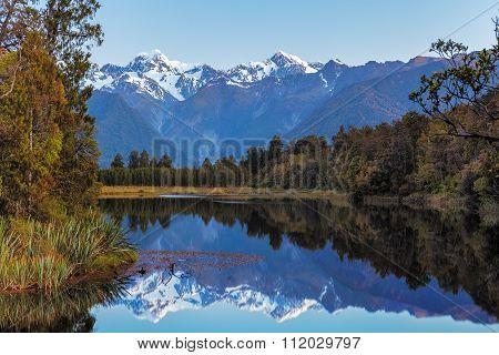 Twin Peaks Reflect In The Beautiful Lake Matheson, New Zealand