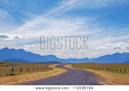 Pastoral Winding Country Road And Mountains In Fiordland, New Zealand