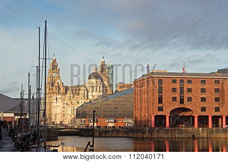 The Albert Dock And Liver Buildings In Liverpool Uk On A Beautiful Sunny Day