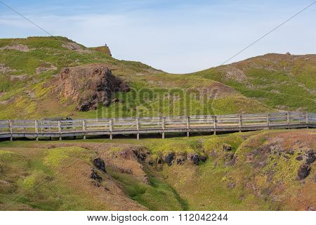 Phillip Island Nature Park - Boardwalk Crossing Velvety Green Hills And Rocky Outcrops