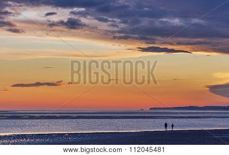 Twho Silhouettes On Inverloch Foreshore Beach At Sunset, Australia