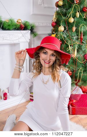 Beautiful Woman In A Red Hat. Christmas Decor.
