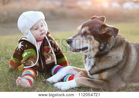 Adorable Baby Bundled Up Outside With Pet Dog