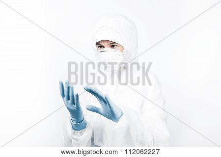 Female professional in hooded suit for bio-hazard protection