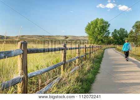 WINDSOR, CO, USA, SEPTEMBER 17, 2015: Morning walk  on Poudre River Trail - paved bike trail extending more than 20 miles between Timnath and Greeley.