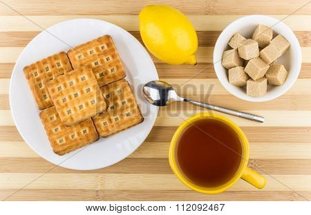 Biscuits In Plate, Cup Of Tea, Bowl Of Lumpy Sugar