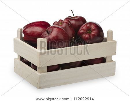 Wooden box with red apples isolated on the white background.