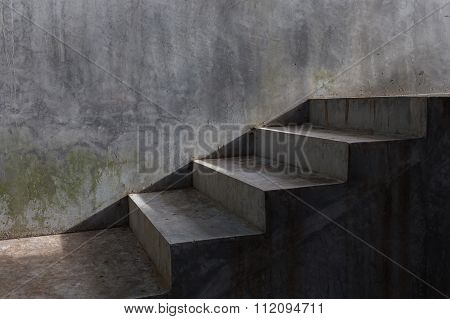 cement concrete staircase with sunshine on mortar wall background poster