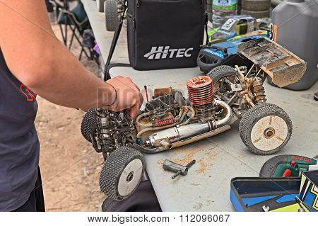 Man Working On The Buggy Car Model