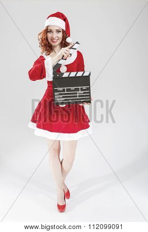 Cinema And Film Production Concept And Ideas. Full Length Portrait Of Smiling Female Santa Helper Gi