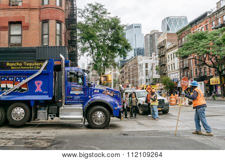 Blue Truck And Road Workers On The Street Of New York.