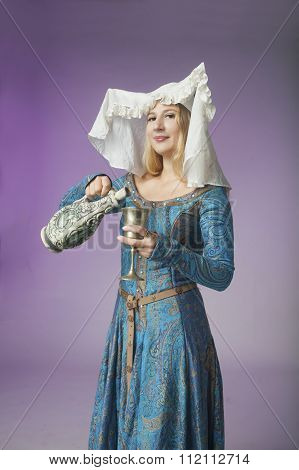 Beautiful Medieval Lady Pouring A Drink