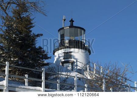 Lighthouse Tower Surrounded By Snow in Maine