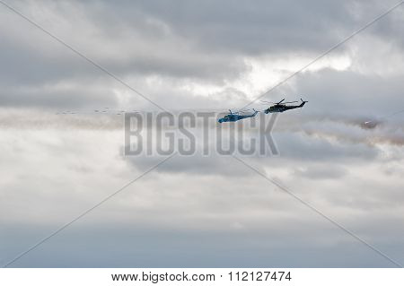 Helicopters MI-24 let out thermal traps and attack