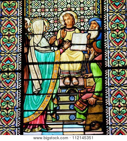 MONTSERRAT SPAIN - JULY 17 2014: Stained glass window depicting The Finding of Jesus in the Temple of Jerusalem in the abbey of Santa Maria de Montserrat in Catalonia Spain
