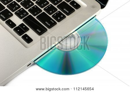 Optical DVD, CD drive on laptop computer on white background, close-up, isolated