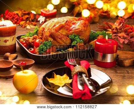 Roasted Turkey. Christmas dinner, table served with turkey, decorated with candles. Roasted chicken, table setting. Christmas dinner