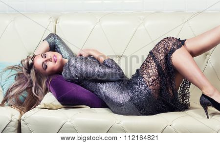 Beautiful Luxurious Woman Lying On A Couch