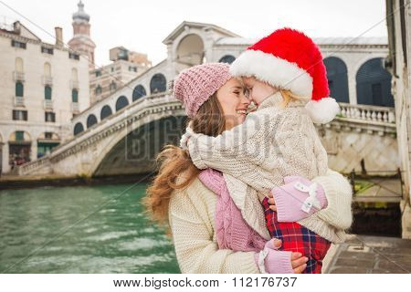 Mother And Child In Santa Hat Hugging Near Ponte Di Rialto