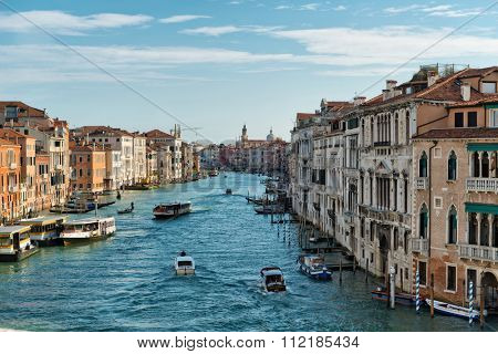 VENICE, ITALY - 17 OCTOBER 2015: Boat traffic on the Grand Canal, Venice with a vaporetto and private boats plying the water between the historic palaces, scenic view. Venice, Italy, 17 October 2015