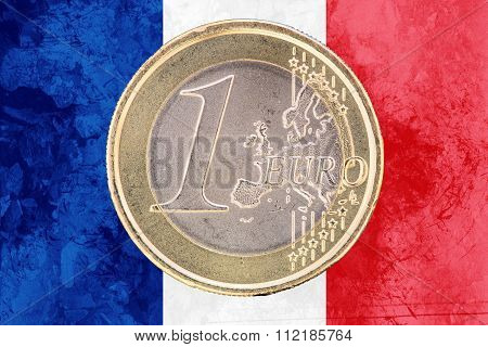 One Euro Coin On The Flag Of France As Background
