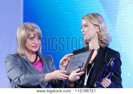 ST. PETERSBURG, RUSSIA - DECEMBER 14, 2015: Deputy minister of culture Alla Manilova (left) presenting award Philanthropist of the Year at the 4th St. Petersburg International Cultural Forum
