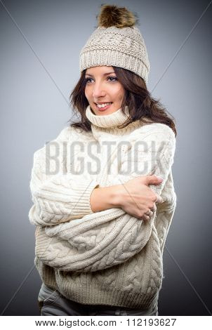 Smiling Young Woman In A Knitted Winter Outfit