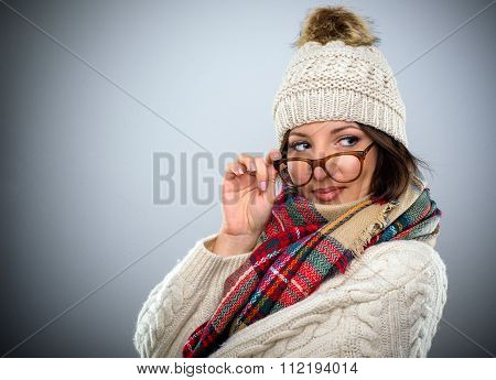 Glamorous Woman Glancing Over Her Glasses