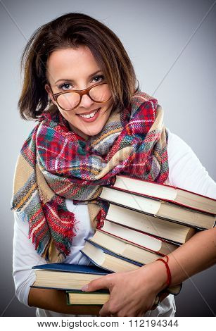 Happy Stylish Woman Holding A Pile Of Books