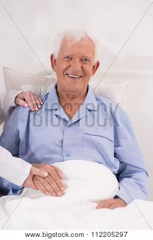 Smiling Elderly Patient In Bed