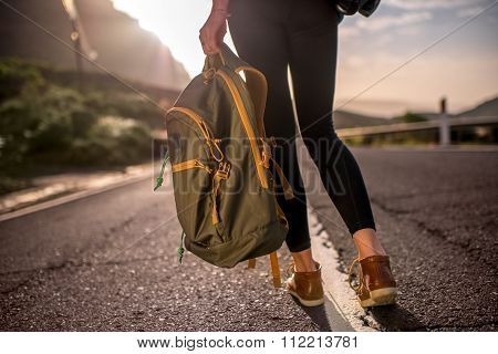 Traveler with backpack on the road