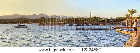 Boat Near A Wooden Pier On The Beach In The Evening In Sharm El Sheikh