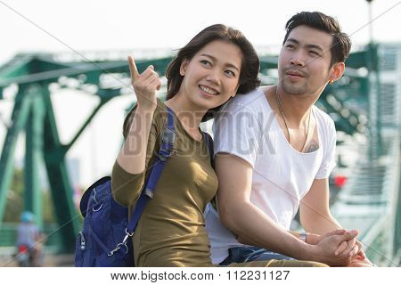 Couples Of Younger Asian Man And Woman Relaxing With Happy Face On Vacation Tirp
