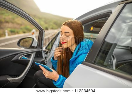 Woman traveling by car on the mountain road